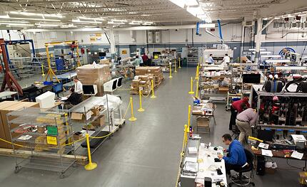Contract Manufacturing Floor with engineers and assemblers hard at work
