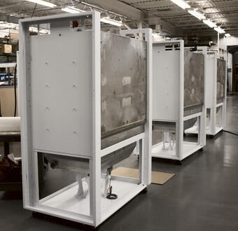 3  white machines in a low-volume production setting
