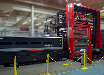 Large red AMADA laser CNC with side stacker for automation